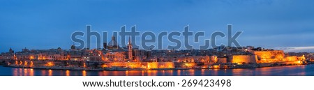 Valletta seafront skyline view as seen from Sliema, Malta. Illuminated historical buildings after sunset. Panorama view. - stock photo