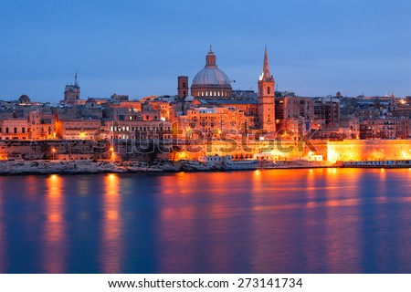 Valletta seafront skyline view as seen from Sliema, Malta. Illuminated historical buildings after sunset.  - stock photo