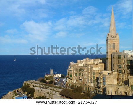 Valletta skyline view with the sea in the distance - stock photo