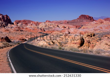 Valley of Fire Valley of Fire is Nevada's oldest state park. These features, which are the centerpiece of the park's attractions, often appear to be on fire when reflecting the sun's rays. - stock photo
