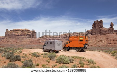 VALLEY OF GODS, UTAH, USA - April 24: Custom Expedition Vehicle RV driving on dirt road in the Valley of Gods, Utah on April 24, 2014. - stock photo