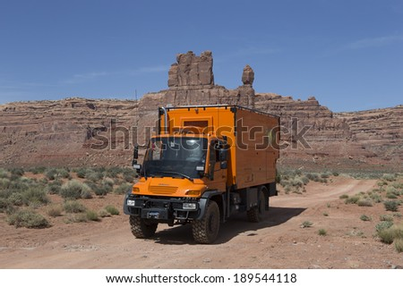 VALLEY OF GODS, UTAH, USA - April 24: Custom Expedition Vehicle RV driving on dirt road in the Valley of Gods, Utah on April 24, 2014.