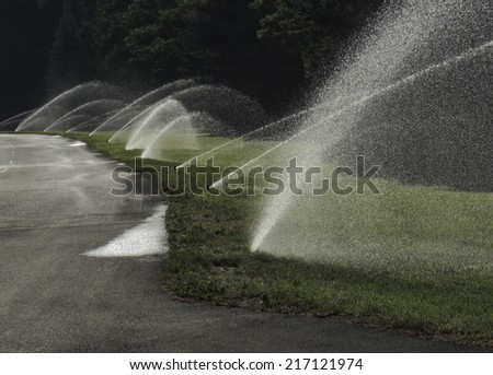 Valley of the Rogue campground irrigation helps keep things green during summer heat wave. Oregon. - stock photo