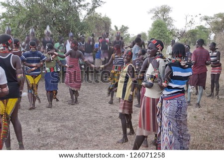 VALLEY OMO, ETHIOPIA - MARCH 12: Unidentified hamer people dance traditional dance at festival dedicated to initiation rite for young men near Dimeka village, March 12, 2012 in Omo Valley, Ethiopia. - stock photo