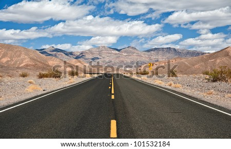 Valley Road in Death Valley National Park - stock photo