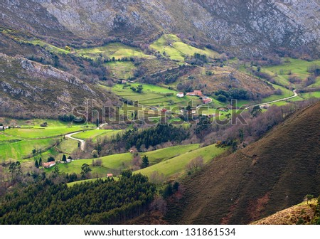 Valley with a small village in Asturias, Spain.