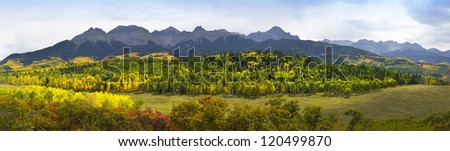 valley with golden and green trees in colorado during fall at east Dallas Creek Ridgway looking at Mt Sneffels
