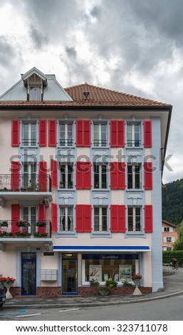 VALLORBE,/ EUROPE - SEPTEMBER 14: Building with red shutters in Vallorbe district Grandes Forges of Switzerland on September 14, 2015