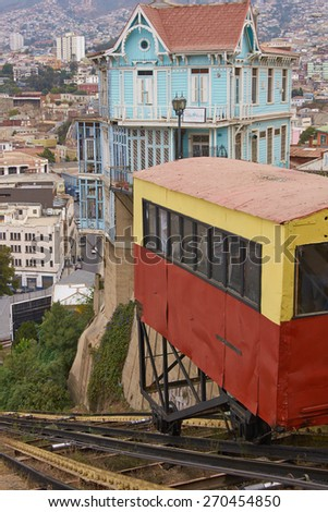VALPARAISO, CHILE - MARCH 23, 2015: Carriage of the historic Ascensore Arttilleria travelling up a steep hillside in port city of Valparaiso in Chile - stock photo