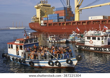 VALPARAISO, CHILE - MARCH 01, 2016: Sightseeing boat filled with tourists in the harbour of the UNESCO World Heritage port city of Valparaiso in Chile. - stock photo