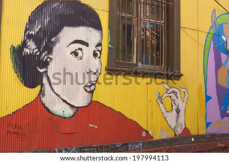 VALPARAISO, CHILE - MAY 27, 2014: Colourful graffiti decorating a street in the world heritage city of Valparaiso in Chile