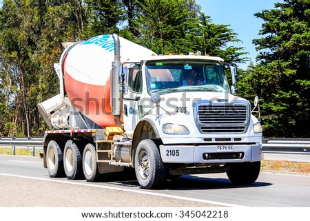 VALPARAISO, CHILE - NOVEMBER 13, 2015: Concrete mixer truck Freightliner Business Class at the interurban freeway. - stock photo