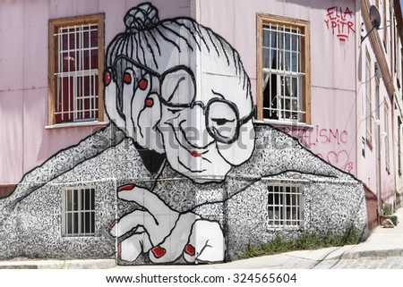 VALPARAISO, CHILE - OCTOBER 29, 2014: Graffiti of an old woman sprayed on a building facade in Valparaiso, Chile. Valparaiso Historic center is a UNESCO world heritage site - stock photo