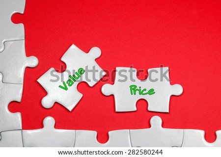 Value Price word on white puzzle - Business Concept - stock photo