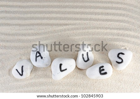 Values word on group of stones with sand background
