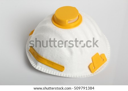 Valved Respirator. Disposable Dust Face Mask. Isolated on a white background.