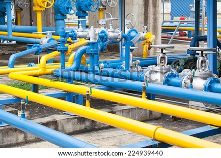Valves at gas plant - stock photo