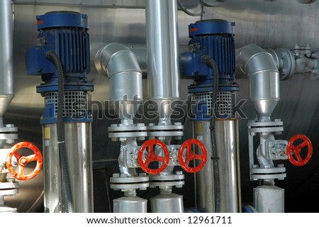 Valves on a pipeline. Red colored - stock photo