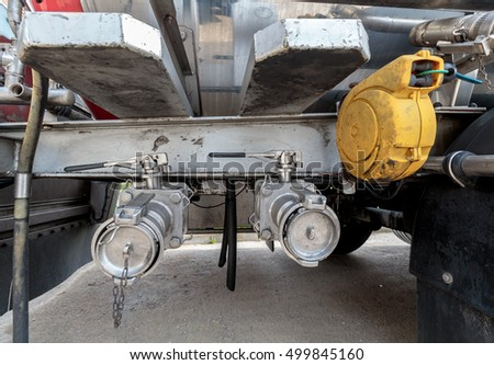 Valves on trailer tank used to dispense liquids like milk and all the way to dangerous goods