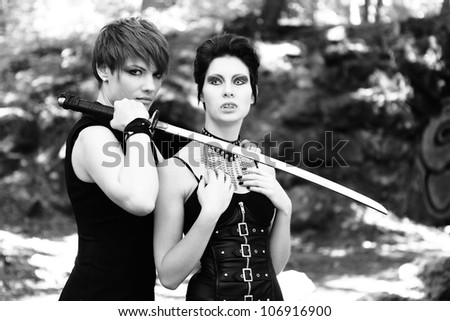 vampire and young warrior woman with sword