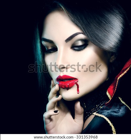 Vampire Halloween Woman portrait. Beauty Sexy Vampire Girl with  dripping blood on her mouth. Vampire makeup Fashion Art design. Attractive model girl in Halloween costume and make up