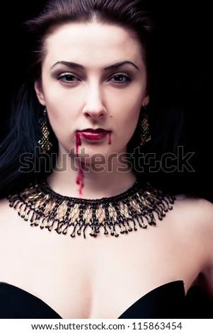 Vampire on black background - stock photo