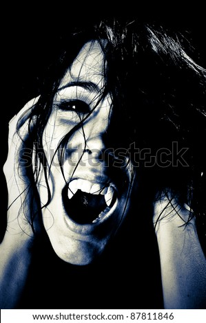 Vampire Screaming in High Contrast - stock photo