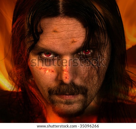 Vampire warrior with scars on his face - halloween theme - stock photo