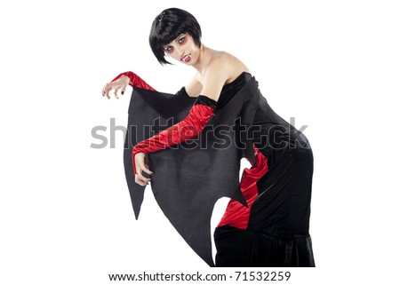Vampire woman in a bizarre position. Isolated on pure white background. - stock photo