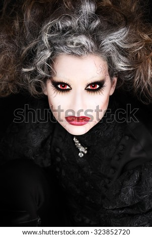 vampire woman portrait, halloween make up - stock photo