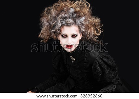 vampire woman portrait, halloween make up - stock photo