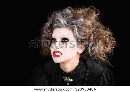 vampire woman portrait with mouth open showing teeth canines, halloween make up - stock photo