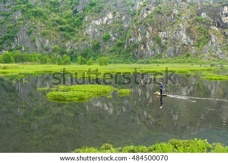 Van Long, Vietnam - May 23, 2016 : Fishermen is fishing on the Van Long Reserve at Ninh Binh, Vietnam