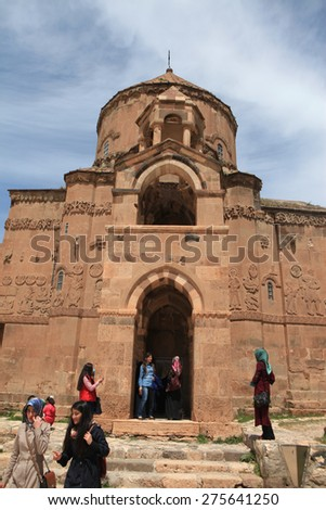 VAN,TURKEY-APRIL 28: Unidentified tourists visiting the Akdamar Church.Armenian Church of the Holy Cross stands on Akhtamar Island (Akdamar) in Lake Van on April 28,2015 in Van,Turkey.
