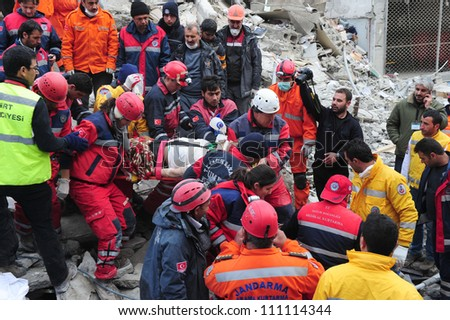 VAN, TURKEY - NOVEMBER 10: Rescue teams search through the buildings destroyed during the earthquake on November 10, 2011 in Van, Turkey
