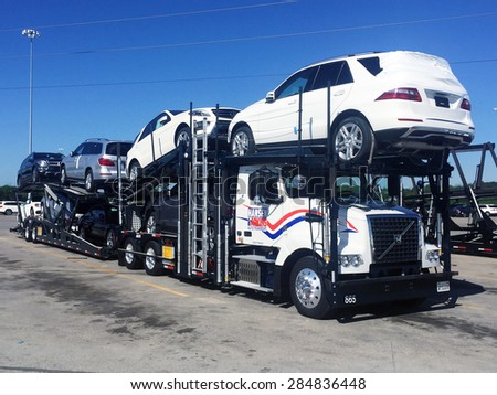 VANCE, AL-MAY, 2015:  Mercedes Benz vehicles being loaded on a transport truck (automotive car carrier) at the factory for delivery to a dealership.   - stock photo