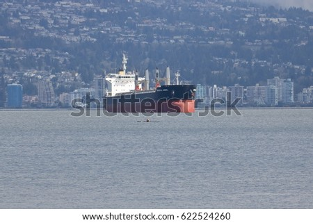 VANCOUVER - April 15,2017: The Oriental Angel, a bulk carrier sailing under the Hong Kong flag, is anchored in the west coast city of Vancouver, Canada on April 15, 2017.