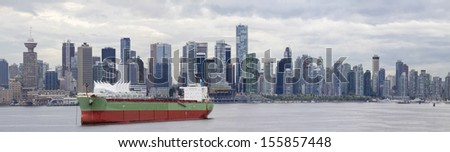 Vancouver BC Canada City Skyline Alone False Creek with Container Ship Panorama - stock photo