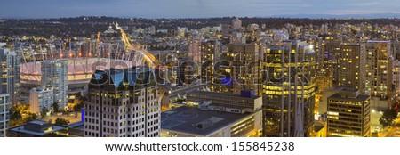 Vancouver BC Canada Downtown with Cambie Bridge over False Creek at Evening Blue Hour Panorama - stock photo