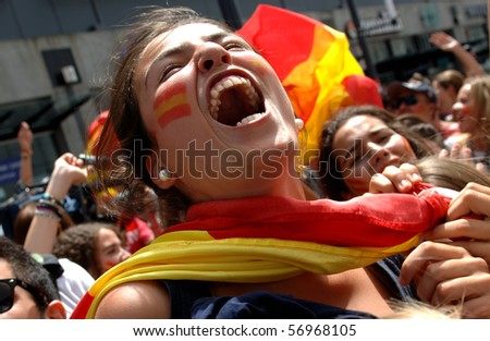 VANCOUVER, BC, CANADA - JULY 11: Spanish fans celebrate Spain soccer team FIFA Soccer World Cup final game victory over Dutch soccer team on Granville Street, July 11, 2010 in Vancouver, BC, Canada - stock photo