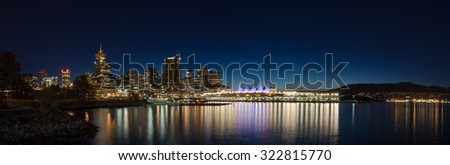 VANCOUVER, BC, CANADA - SEPT 12, 2015: Downtown Vancouver and Canada Place at night, with the North Shore mountains in the background.