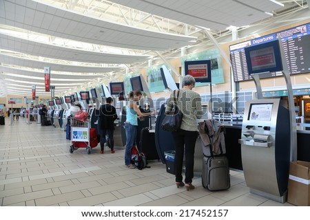 Vancouver, BC Canada - September 13,  2014 : Self check in counter inside YVR airport in Vancouver BC Canada.