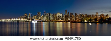 Vancouver BC Canada Skyline along False Creek from Stanley Park at Blue Hour Panorama - stock photo