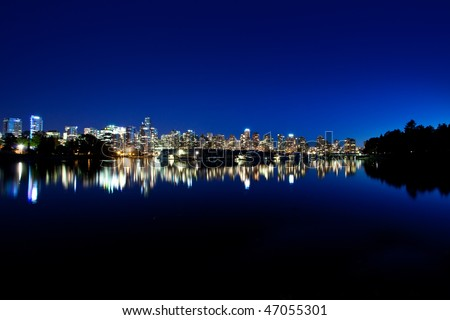 Vancouver BC evening skyline from Stanley Park - stock photo