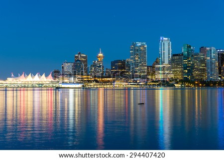 VANCOUVER, BC - JUNE 20, 2015 - Vancouver skylines with light reflection at blue hour. The view from Stanley Park. A colorful cityscapes.