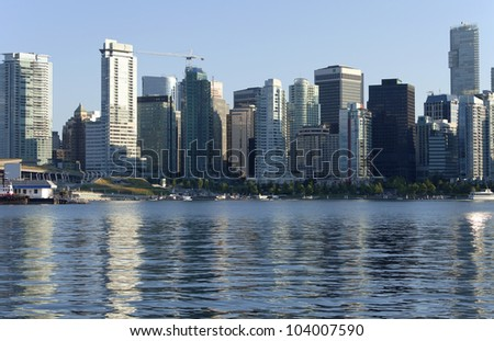 Vancouver BC skyline and tourist hydroplanes.