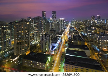 Vancouver British Columbia Canada Cityscape along Robson Street at  Night Aerial View - stock photo