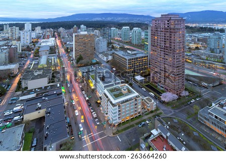 Vancouver British Columbia Canada Cityscape with Robson Street Light Trails and Stanley Park View at Dusk - stock photo