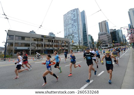 VANCOUVER, CANADA - APRIL 21, 2013: Thousands of participants run the streets during annual Vancouver Sun Run in Vancouver, Canada, on April 21, 2013. - stock photo
