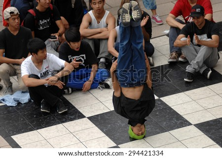 VANCOUVER, CANADA - AUGUST 4, 2012: Dancers take part in the public Street Dance Festival at Robson Square in Vancouver, Canada, August 4, 2012. - stock photo